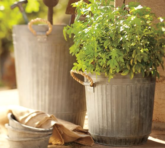 Ribbed galvanized metal bucket with rope handles pottery for Metal bucket planter