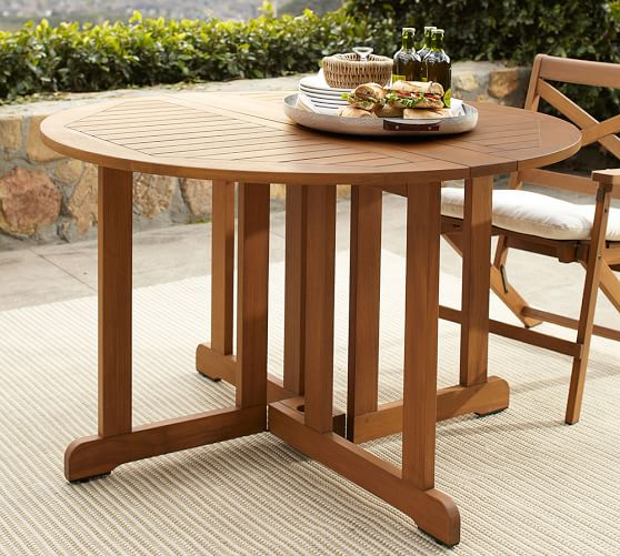 Hampstead teak round drop leaf dining table honey for Outdoor teak dining table